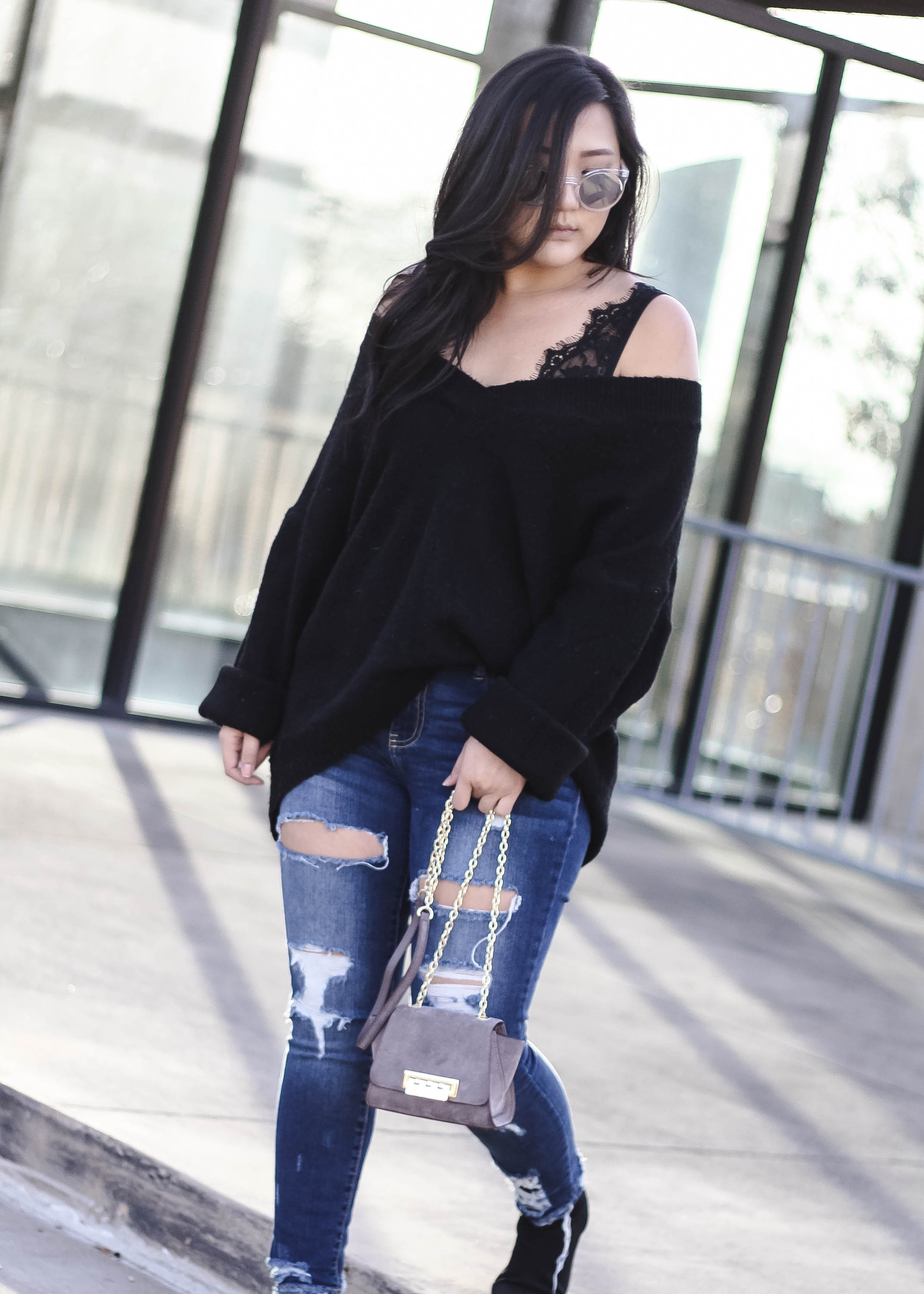 Image of Inthegreyblog.com Denim Style in Ripped Denim Jeans, V-neck Sweater, Clear Round Quay Australia Sunglasses, Black Lace Bralette and Zac Posen Mini Eartha Iconic Crossbody bag Outfit